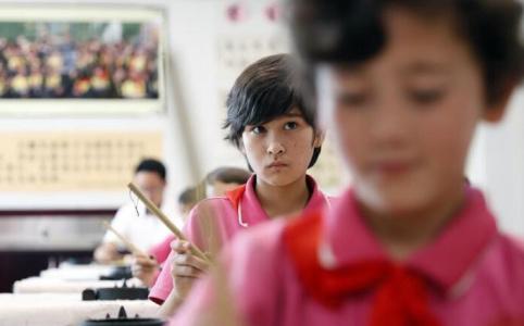 70年,从文盲占八成走向高等教育普及化